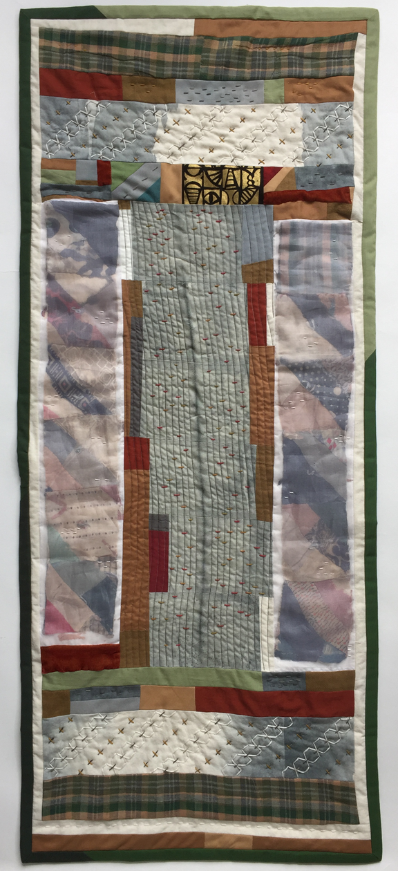 quilt in long panels with line down center