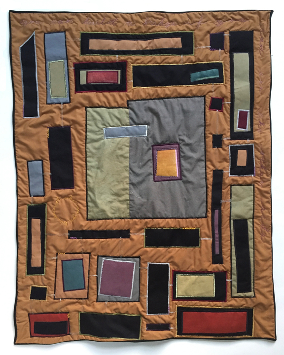 quilt of multicolored rectangles connected with silver threads and embroidered text