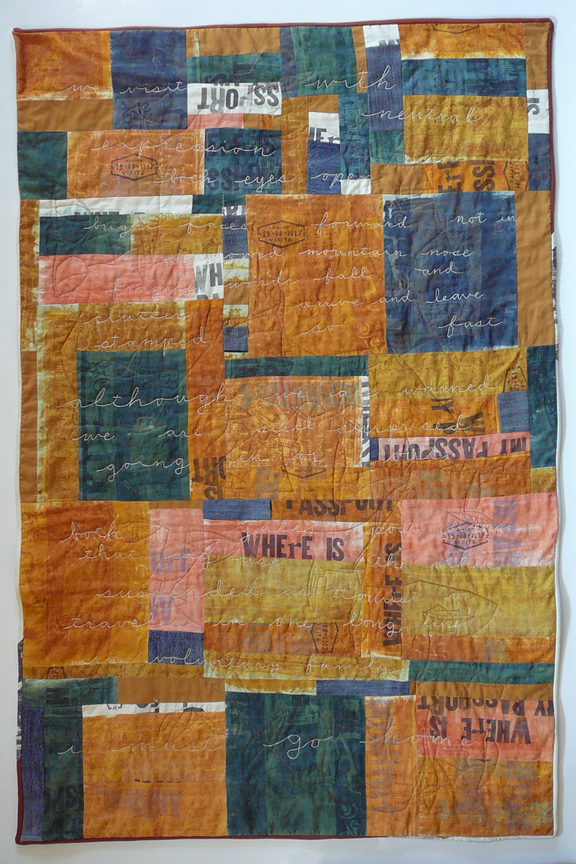 quilt with words and images taken from a passport with stitching of faces