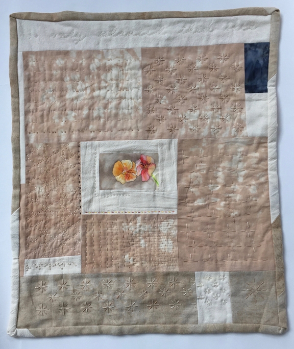 quilt with small painting of nasturtiums and lots of stitching