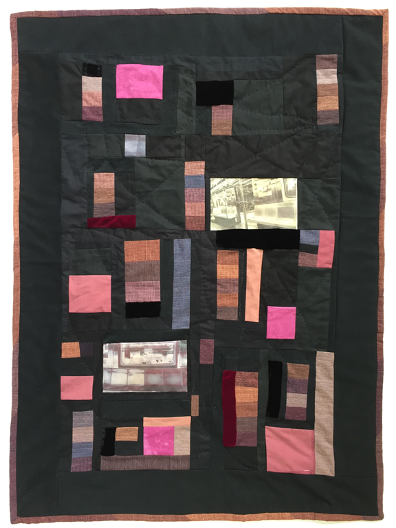 pieced quilt with colored patched surrounded by black and two photos of empty New York City subway cars