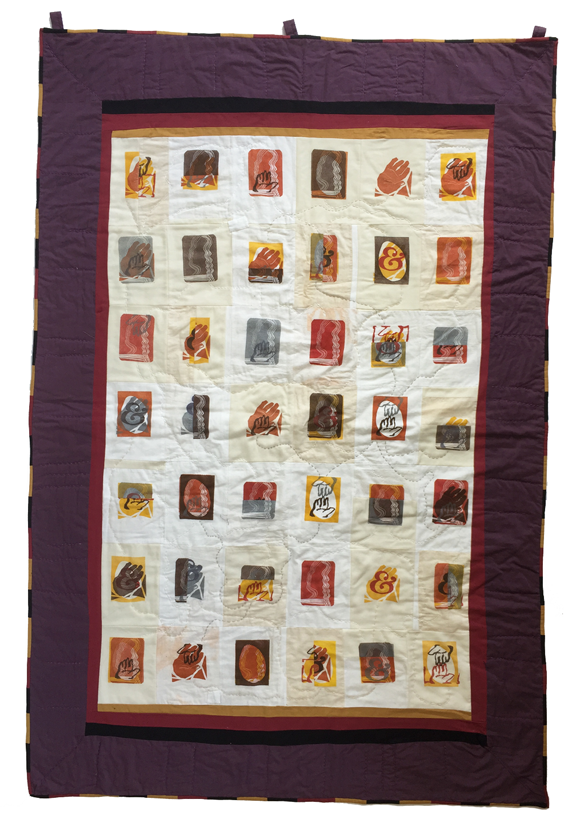 block quilt with various prints of hands and people