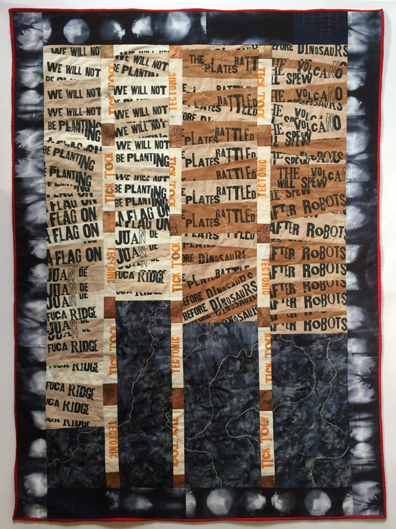 quilt with fragments of text and stitching like topographic map