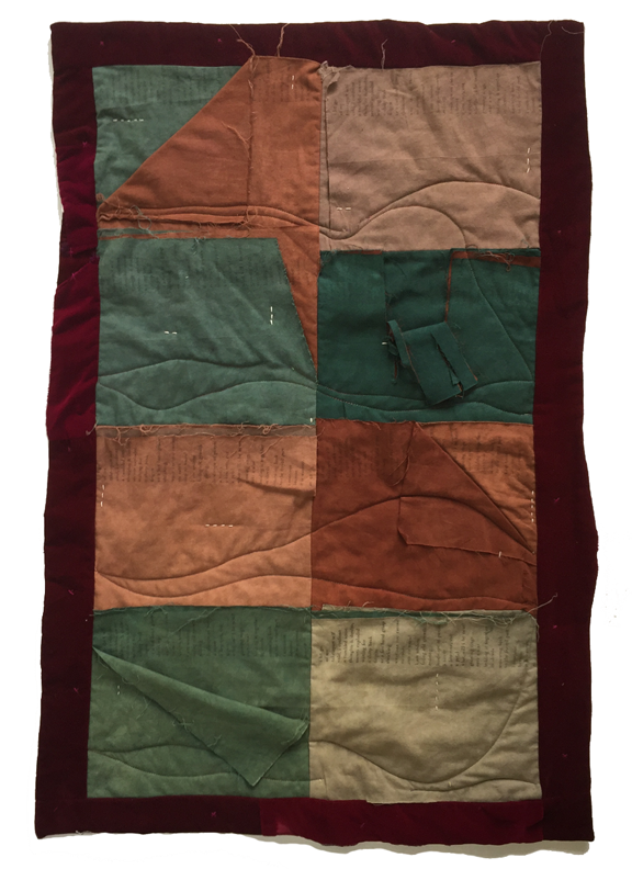quilt with layers of fabric that are torn and stitched with a poem printed on them